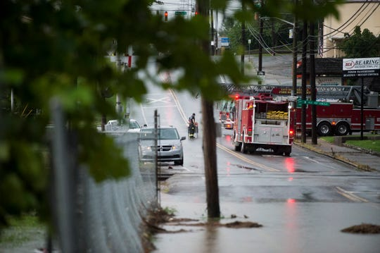 An area of West Baxter Avenue is flooded where it intersects with Second Creek in Knoxville Monday, July 22, 2019.