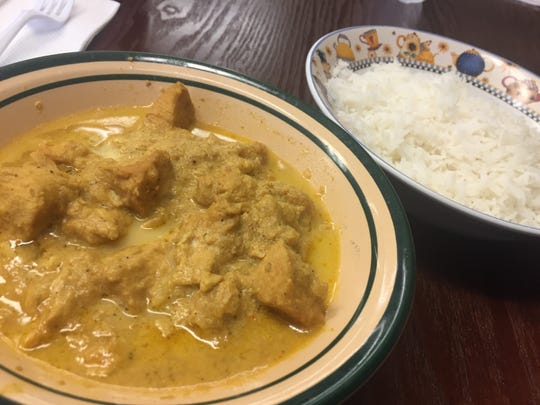 Butter chicken with rice on the side at Masala IndoPakGrill in Maryville