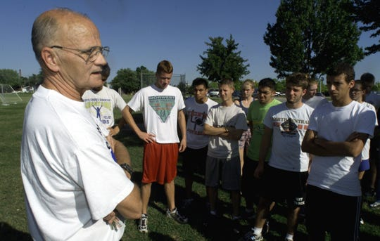 Former Lafayette Jeff cross country coach Phil Hurt talks to his team at a practice in 2000. Hurt passed away last Thursday.