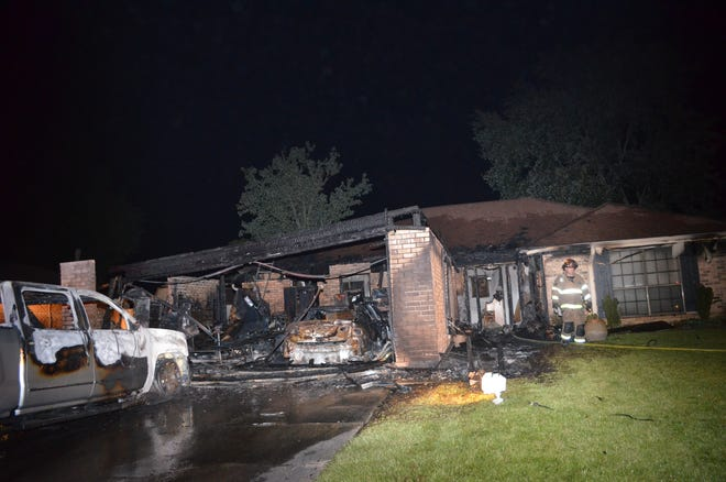 A fire in north Lafayette damaged two cars, the garage and part of the attic.