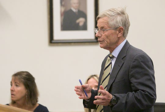 Larry Willey, defense attorney for former Judge Theresa Brennan, discusses her availability for a criminal trial, set to begin in January, 2020, speaking to visiting Judge Paul Cusick at the Judicial Center in Howell, Monday, July 22, 2019.