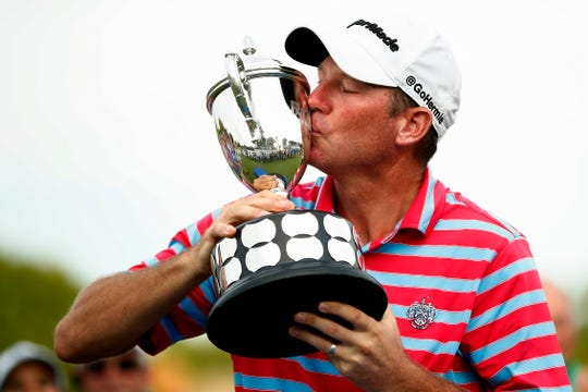 Jim Herman kisses the trophy after winning the PGA Barbasol Championship golf tournament at Keene Trace Golf Club's Champions Course in Nicholasville, Ky., Sunday, July 21, 2019. Herman, a Palm City resident, will compete at this weekend's Honda Classic in Palm Beach Gardens.