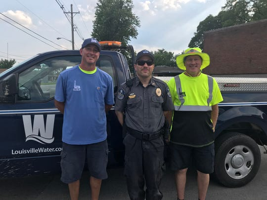 Photo: Chad Harper (left) and Jimmy Stone (right) are pictured with Metro Animal Services member after rescuing a kitten from a hydrant last summer.