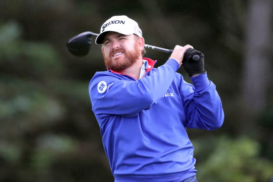 J.B. Holmes of the U.S. plays off the 5th tee during the first round of the British Open Golf Championships at Royal Portrush in Northern Ireland, Thursday, July 18, 2019.