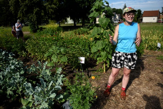 Lansing resident Stephanie Onderchanin works for a non-profit organization that helps maintain Riddle Elementary School's garden and others in the city. Riddle's garden hosts a community cookout once a week this summer.