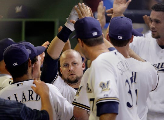 ' Casey McGehee is congratulated in the dugout after hitting a grand slam during the sixth inning of a baseball game against the New York Mets Monday, June 29, 2009.