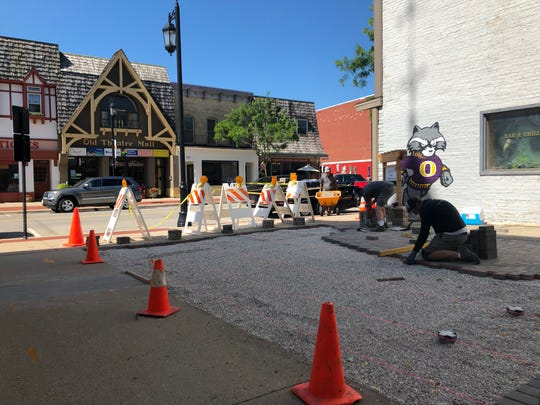 Workers construct the Wizard of Oz Plaza in Oconomowoc, which is expected to be finished in time for the 80th anniversary of the premiere of the classic film.