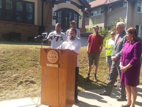 Carl Quindel of Strong Blocks speaks at a news conference about the Milwaukee Employment/Renovation Initiative.