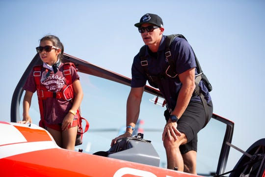 As part of EAA Young Eagles program, Green Bay Packers tight end Jimmy Graham flies with 12-year-old Madeline Anderson at EAA AirVenture in Oshkosh, Wisconsin on Monday, July 22, 2019.