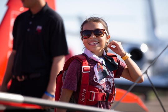 12-year-old Madeline Anderson smiles after flying with Green Bay Packers tight end Jimmy Graham as part of EAA Young Eagles program at EAA AirVenture in Oshkosh, Wisconsin on Monday, July 22, 2019.