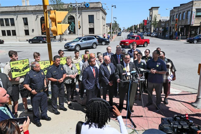 Alderman Bob Donovan speaks at the press conference to announce new initiative to target reckless driving that will focus on intersections in the city that have proven to be hotspots for crashes and reckless driving.  The event was held at one of those intersections, Cesar Chavez Drive at the intersection with West Greenfield Avenue.