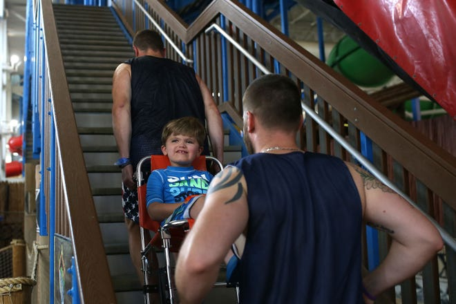 One of the ways Assist WI helps people with disabilities enjoy the Dells is by carrying people up the stairs of waterslides.