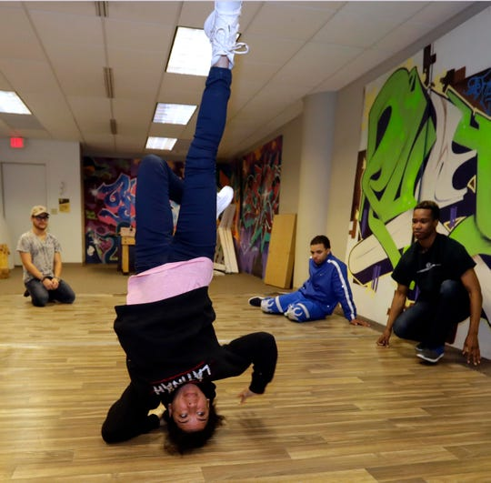 "Break dancer Ana ""Rokafella"" Garcia demonstrates some moves for students at True Skool, as part of a hip-hop youth mentorship program. True Skool received a $50,000 grant from the Joyce Foundation, and is offering students time to work with three female hip-hop veterans on a special show being performed at the True Skool Block Party at the Marcus Center July 27."