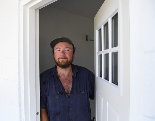 """Mark Bertel stands in the doorway to one of the """"micro-flats"""" under construction on the property formerly known as the Town and Country Motor Inn."""