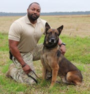 Department of Corrections narcotics dog K-9 Jake, pictured with his handler, Sgt. Quinn Jones, died last weekend after he had an allergic reaction to a substance inside an Elmore County prison.