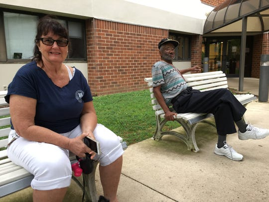 Vickie Aiyegbusi and Merlin Cox sit in front of Gillespie Towers on Monday.