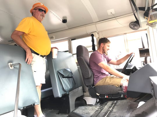 Dickson County School District bus driver Steve Manley, left, trains new bus driver Drew Daughtery.