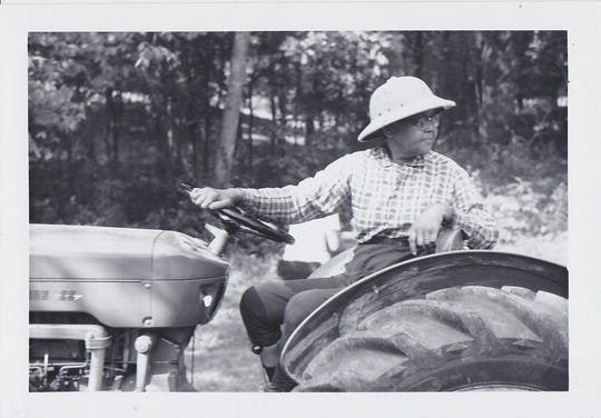 "Josephine Groves Holloway was a civil rights pioneer founder of Middle Tennessee's first Girl Scout troops for African-American girls in the 1920s. Her troops remained ""unofficial"" until 1943, when Holloway finally successfully petitioned for Troop 200's acceptance. Holloway also started a camp for the girls in Millersville, which she often up kept herself, like this photo of her on the tractor. A historical marker in her honor is being installed in Nashville."
