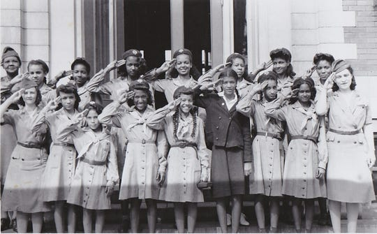 "Josephine Groves Holloway was a civil rights pioneer founder of Middle Tennessee's first Girl Scout troops for African American girls in the 1920s. Her troops, one of which is pictured here, remained ""unofficial"" until 1943, when Holloway finally successfully petitioned for Troop 200's acceptance. A historical marker in her honor is being installed in Nashville. The script on the back of this historic photo from the Girl Scouts reads: ""1st G.S. Troop Registered after return to scouting - org. Oct. 42 - registered May 1943 retroactive to Oct 1942."" Holloway is at the far left of the photo in the back row. Two of her daughters, Weslia and Josephine, are the third and fourth Girl Scouts from the left."