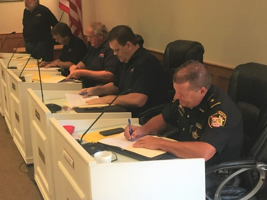 Etna Township Trustees and Sheriff Randy Thorp sign contracts Saturday, July 20, for the department to provide Etna policing.