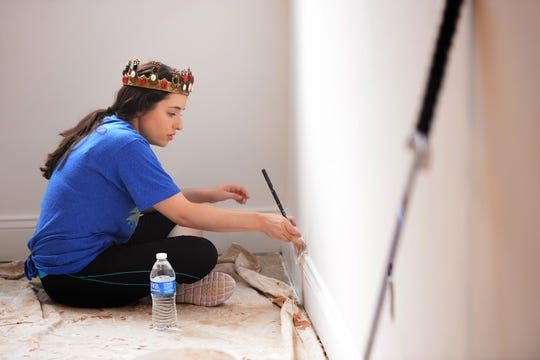 "Monica Garza, ""Queen Isabella"" from Medieval Times helps with painting as Medieval Times partners with Habitat For Humanity Bergen County to assist with their build project in Washington Township on 07/22/19. Habitat Bergen is building four 2-bedroom affordable homes. Two will be for military veterans and two will be for seniors."