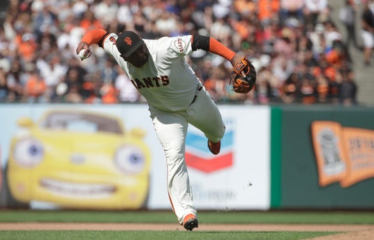 San Francisco Giants third baseman Pablo Sandoval fields an infield single hit by New York Mets' Todd Frazier during the twelfth inning of a baseball game in San Francisco, Sunday, July 21, 2019. (AP Photo/Jeff Chiu)