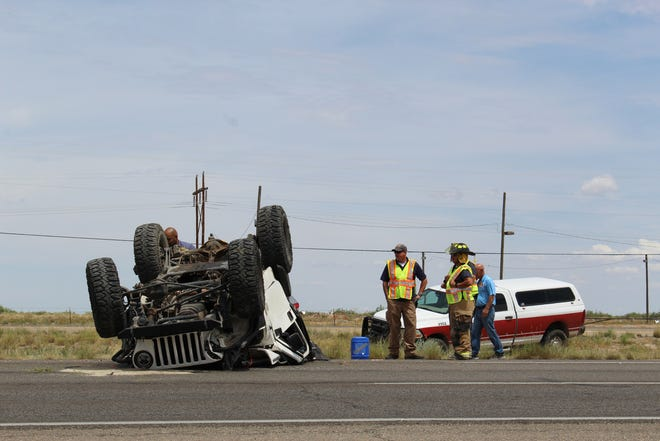 Fire responders and New Mexico State Police respond to a Jeep rollover accident off Highway 70 in Alamogordo Monday afternoon.