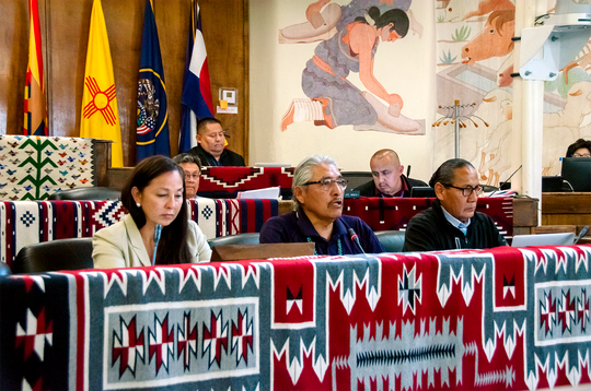 Delegate Elmer Begay, center, talks on July 16 about his bill to shift the tribe's energy production from coal to renewable sources during the Navajo Nation Council summer session in Window Rock, Arizona.