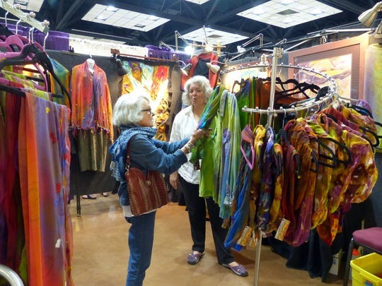 Wearable art was featured at this seller's station.