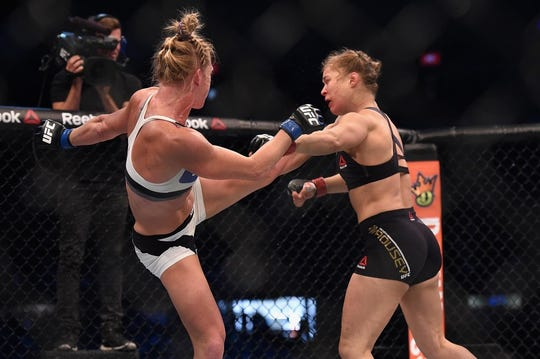Nov 15, 2015; Melbourne, Australia; Ronda Rousey (red gloves) competes against Holly Holm (blue gloves) during UFC 193 at Etihad Stadium. Mandatory.