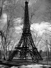 The town historical park in Paris features a  much smaller replica (20 feet) of  the Eiffel Tower (1,063 feet).