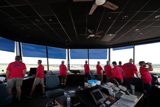 Air Traffic Controllers work in the Wittman Regional Airport's control tower to direct air traffic for EAA AirVenture Sunday, July 21, 2019 in Oshkosh, Wisconsin.