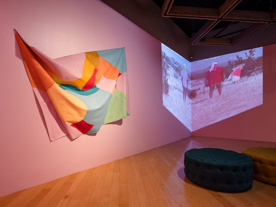 The Adee Roberson room, featuring one of her canvases and performance art videos.