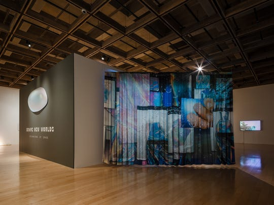 The curtain that hangs at the beginning of Fu's space. Her video can be seen in the background.