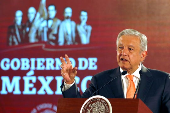 FILE - In this April 9, 2019 file photo, Mexican President Andres Manuel Lopez Obrador speaks during a signing ceremony in an agreement with the United Nations High Commissioner for Human Rights, at the National Palace in Mexico City. Mexican officials said Monday, July 22, 2019, they have uncovered an industrial-scale migrant smuggling ring using tractor-trailer rigs disguised as freight deliveries for major companies. Lopez Obrador said authorities found a tractor-trailer disguised with the logo of a major grocery store chain. But instead of groceries, it was carrying about 150 migrants.