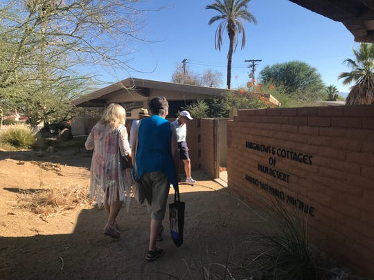 Property manager Arleen Benson, front, leads members of the Historical Society of Palm Desert and others through some bungalows headed for demolition on Saturday, July 20, 2019. All but one of the four bungalows, designed by mid-century modern architect Walter S. White, are deemed uninhabitable and may be demolished this summer.