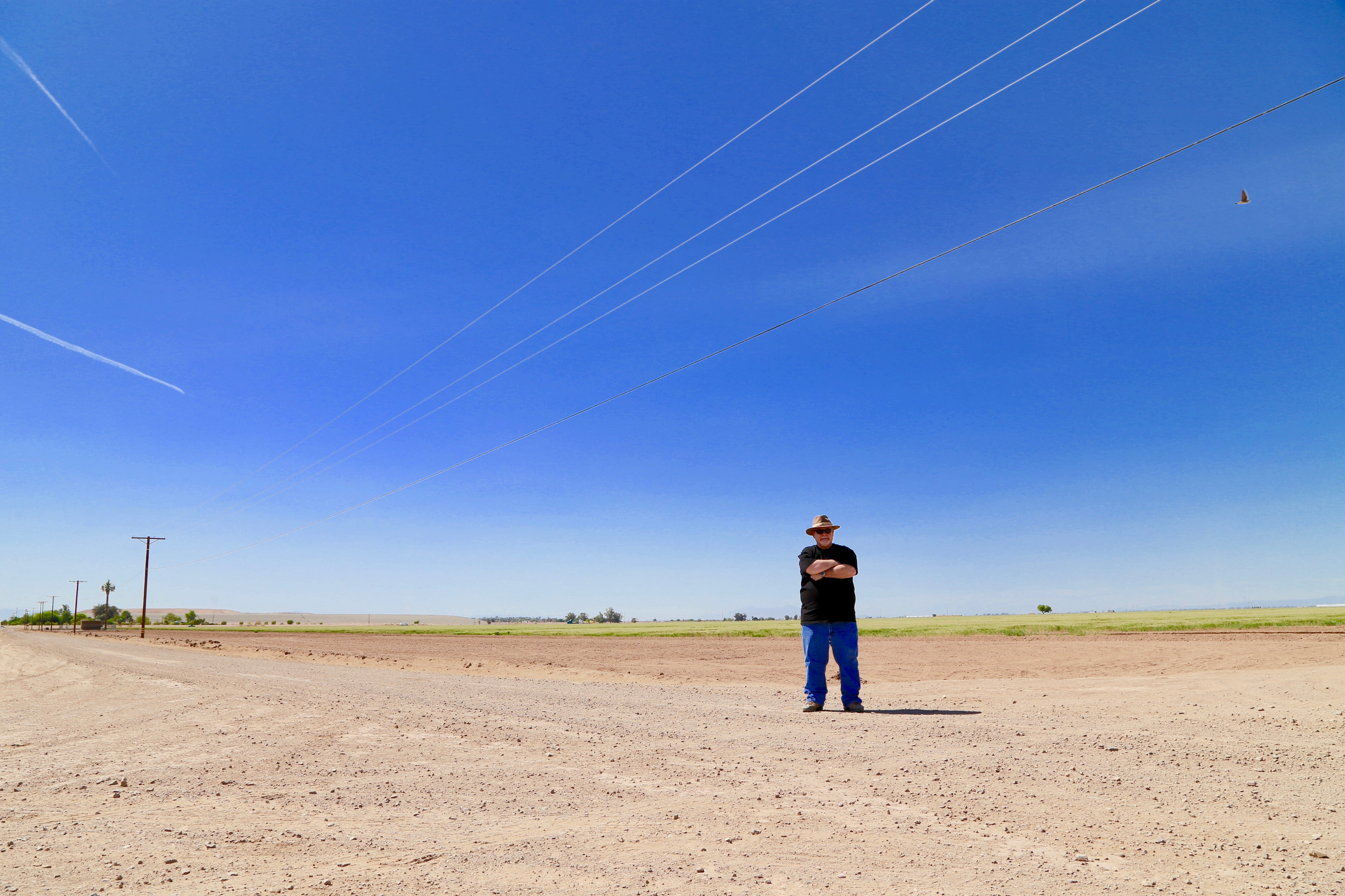 John Grasson stands at a dirt road intersection in Imperial, Calif., where he believes a Viking ship may be buried.