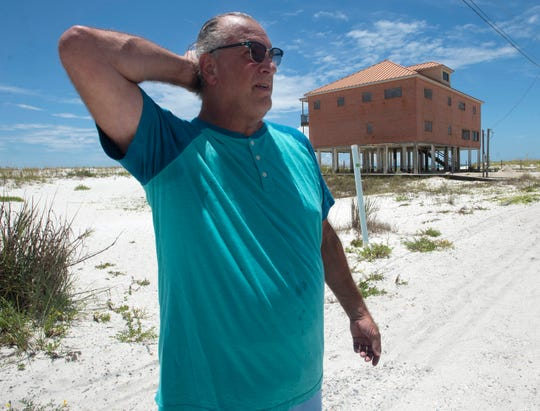 Terry Pirman, president of the Sailmaker Cove Homeowners Association, says he plans to continue to fight to either restore an abandaonned Navarre Beach house or get it bulldozed.