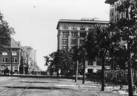 Street car tracks are pictured in the 1920s on Palafox Street in downtown Pensacola.
