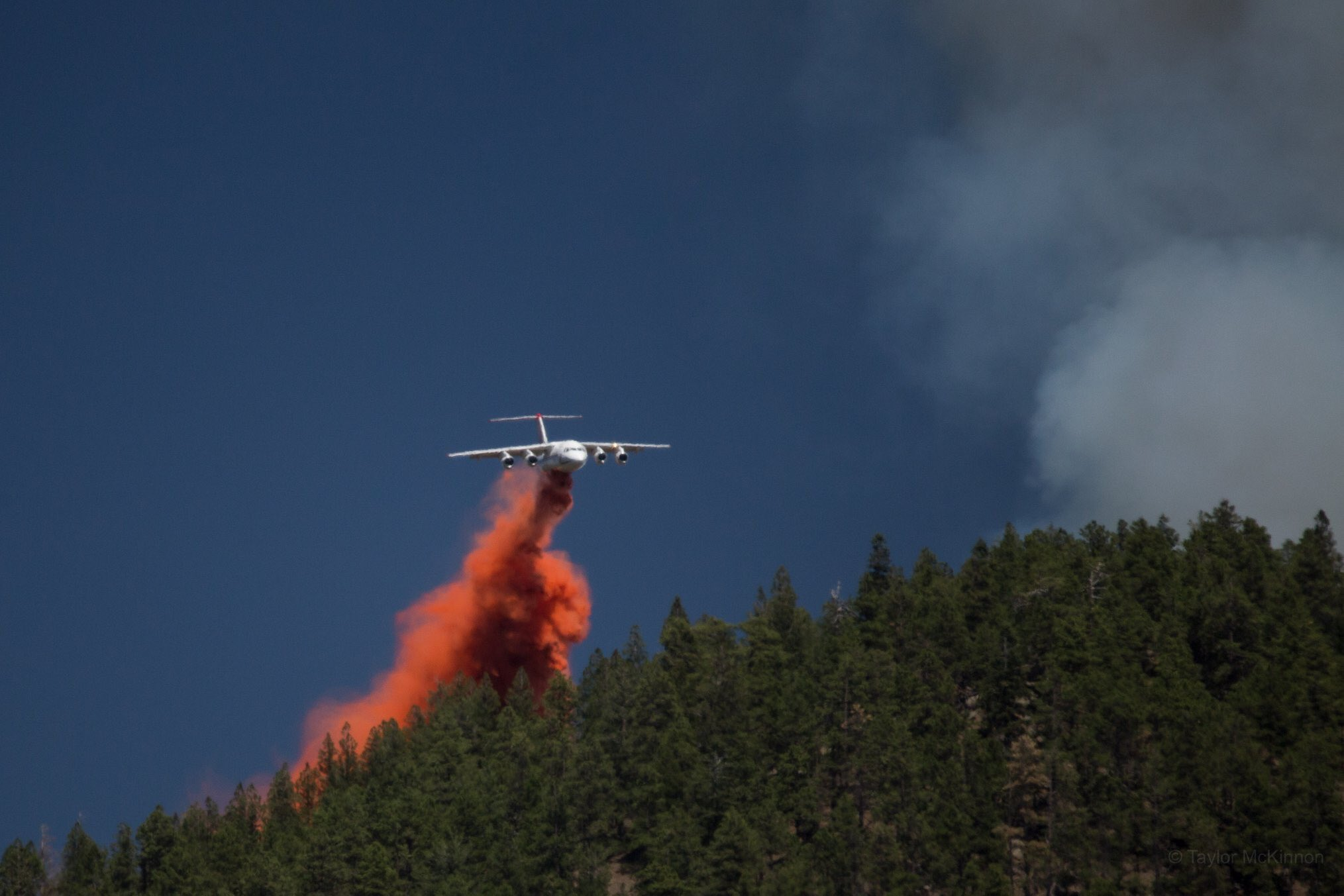 A plane drops fire retardant over the Museum Fire on July 21, 2019.
