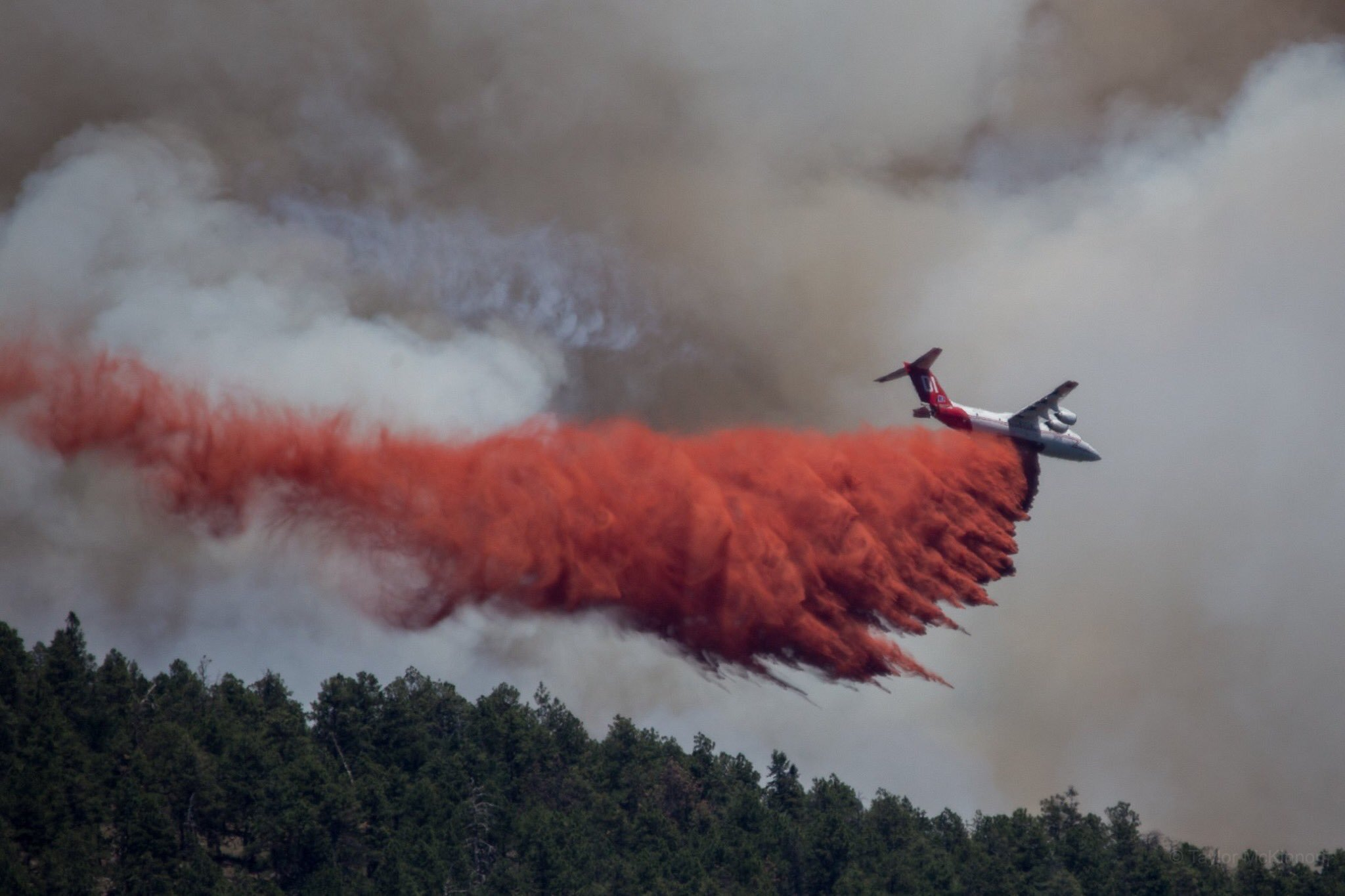 A plane drops fire retardant over the Museum Fire on July 22, 2019.