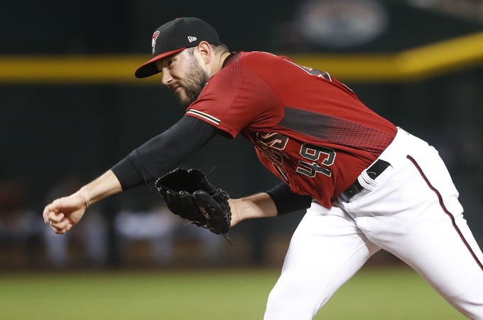Diamondbacks' Alex Young (49) pitches during the first inning against the Brewers at Chase Field in Phoenix, Ariz. on July 21, 2019.
