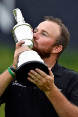 Shane Lowry celebrates after winning The Open Championship golf tournament during the final round at Royal Portrush Golf Club - Dunluce Course on July 21, 2019.