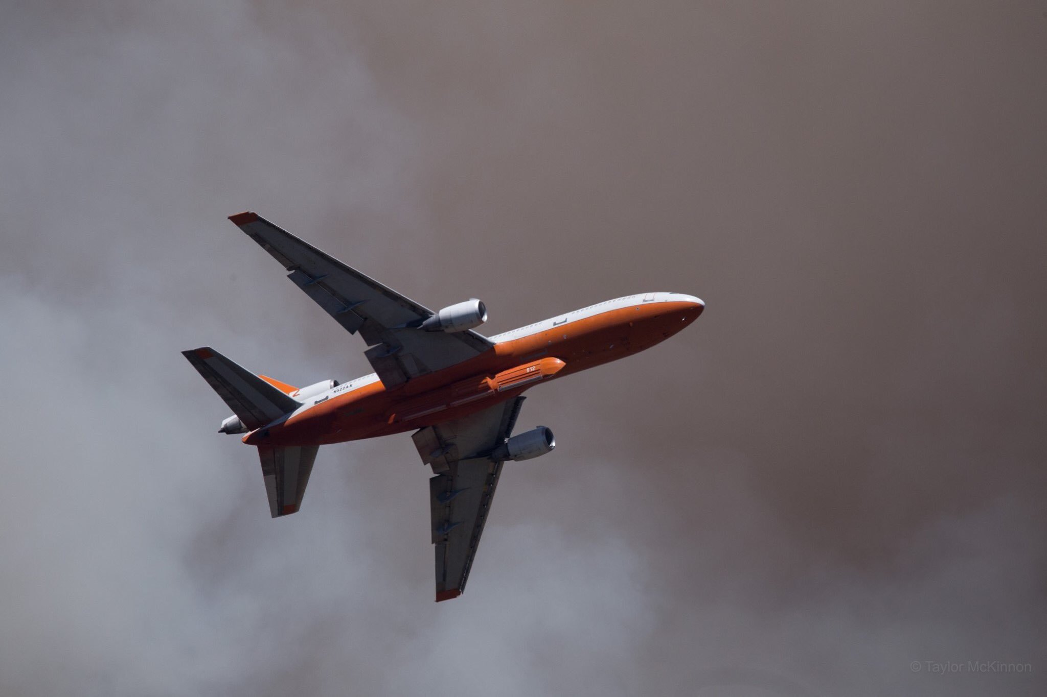 A plane flies over the Museum Fire on July 22, 2019.