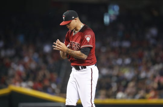 Diamondbacks' Yoan Lopez (50) reacts after giving up a run in the eighth inning at Chase Field in Phoenix, Ariz. on July 21, 2019.