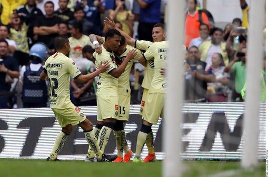 América celebra uno de sus goles ante Monterrey.