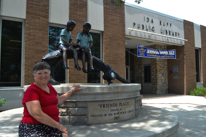 Terry Zeman sits at Friends Plaza, one of the many projects funded by The Friends of the Ida Rupp Public Library.