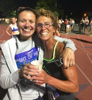 Marisa Strange, right, and Renee Tolan celebrate moments after Strange's record run.