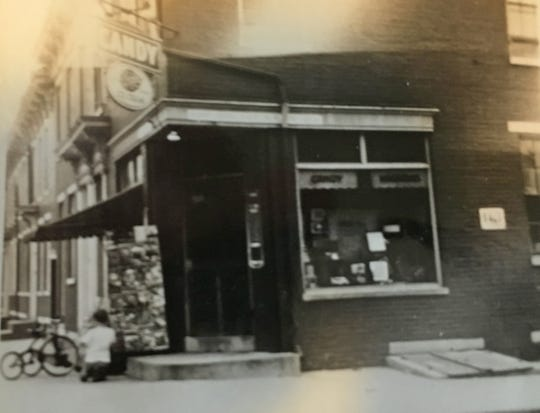 Photo taken around 1943 of my father's Candy Store at Duke and Maple streets. The Breyers ice cream sign above the doorway would bring in people for a cooling treat during the hot summer months. The boy with the tricycle in the photograph is not identified. The store would begin selling snowballs several years later.