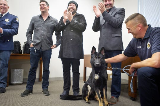From left to right: York County Sheriff Richard Keuerleber, members of band Live, Chad Gracey, Chad Taylor and Patrick Dahlheimer, and Lt. David Godfrey, stand with Dargo, a K-9, shortly after he received his badge at the York County Judicial Center in this file photo from May 13, 2013.